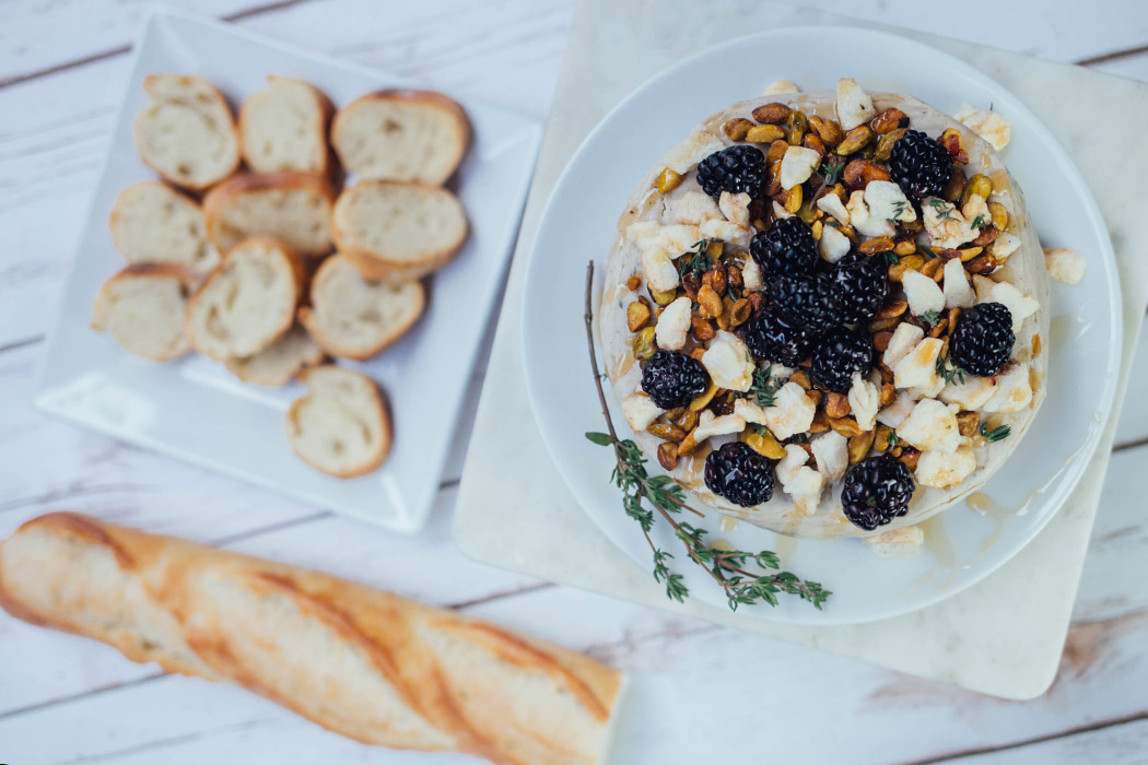 Plant Based Cashew Brie, topped with fruit and nuts